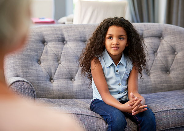 young girl on couch at therapy