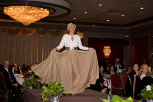 woman white big skirt poses on stage