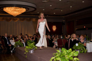 woman in white dress takes the stage