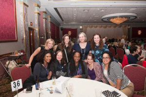 friends gather at fashion show event