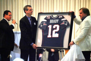 Mike with brady jersey for raffle